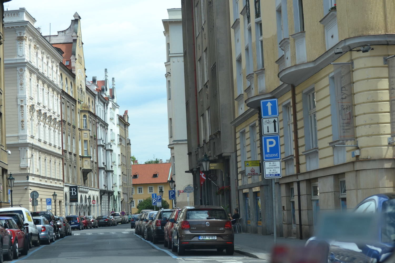 Cars and buildings along a street