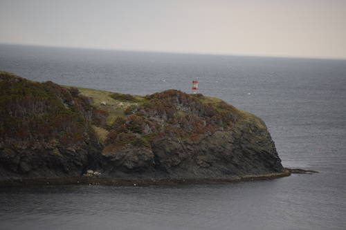 Mountain Beside the Water with a Lighthouse in Newfoundland