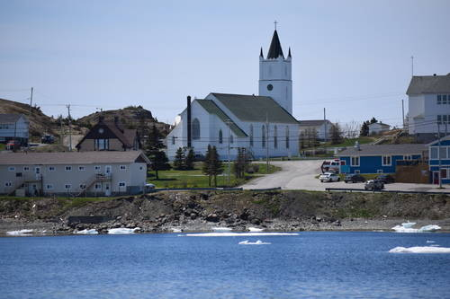 Town and Church Building Beside the Water in Newfoundland
