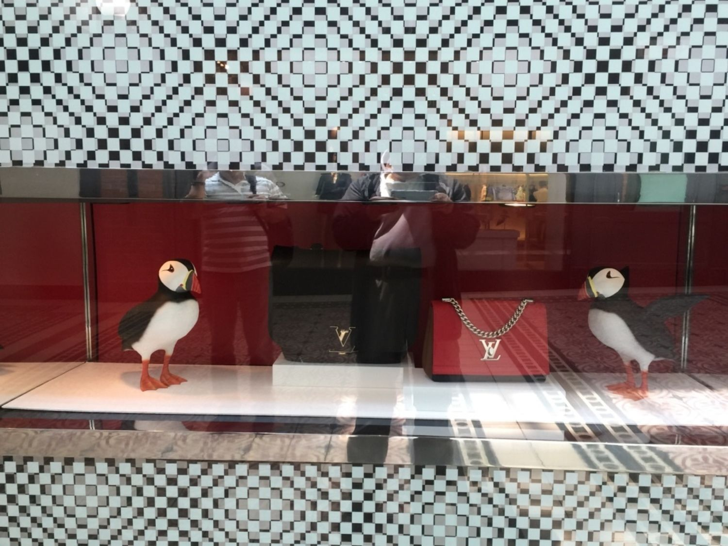 87dd05d9a80 Show Window of LOUIS VUITTON with Bags and Penguins at V   A Waterfront Mall