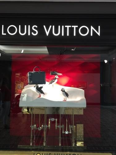 Louis Vuitton's Show Window in Gold and Red with Bag, Shoe and Penguins