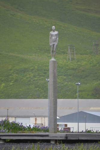 Statue of a Person Standing on a Pole in Iceland, Art
